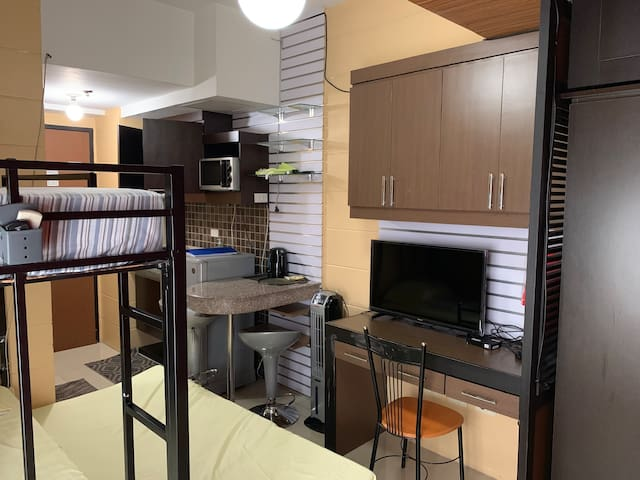 Condo unit stone's throw away from UST