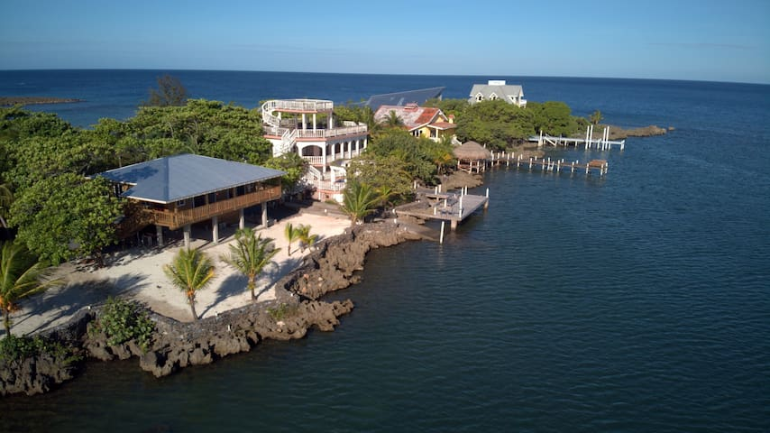 Waterfront and brand new! Have a dip or snorkel out to the amazing Gibson Bight reef just outside the doors of this awesome get-a-way in paradise! Go to sleep with the relaxing sounds of the Caribbean Sea and wake up to picturesque sunrises here!