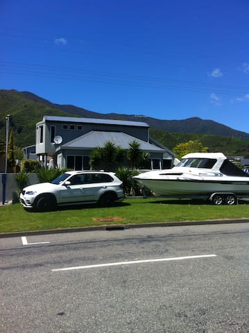 Private parking for a car and boat trailer ,handy at busy boating days.