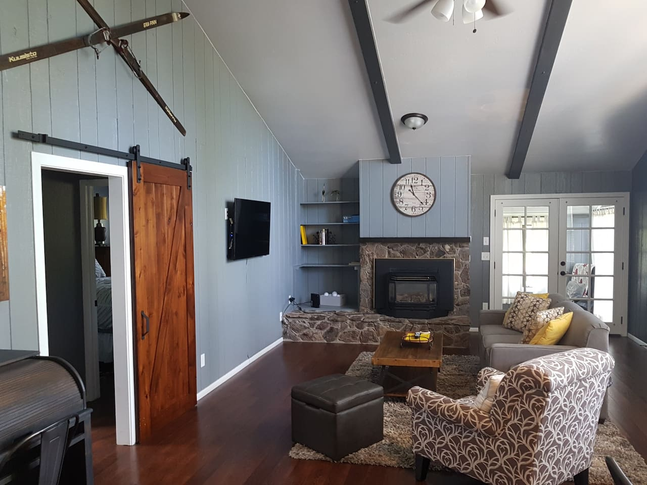 Great room includes fireplace and lots of natural light with view of Mount Elden, perfect for winter ski cabin or high elevation summer retreat. Barn door to Master bedroom and bath. French doors open to sunroom/ second bedroom.
