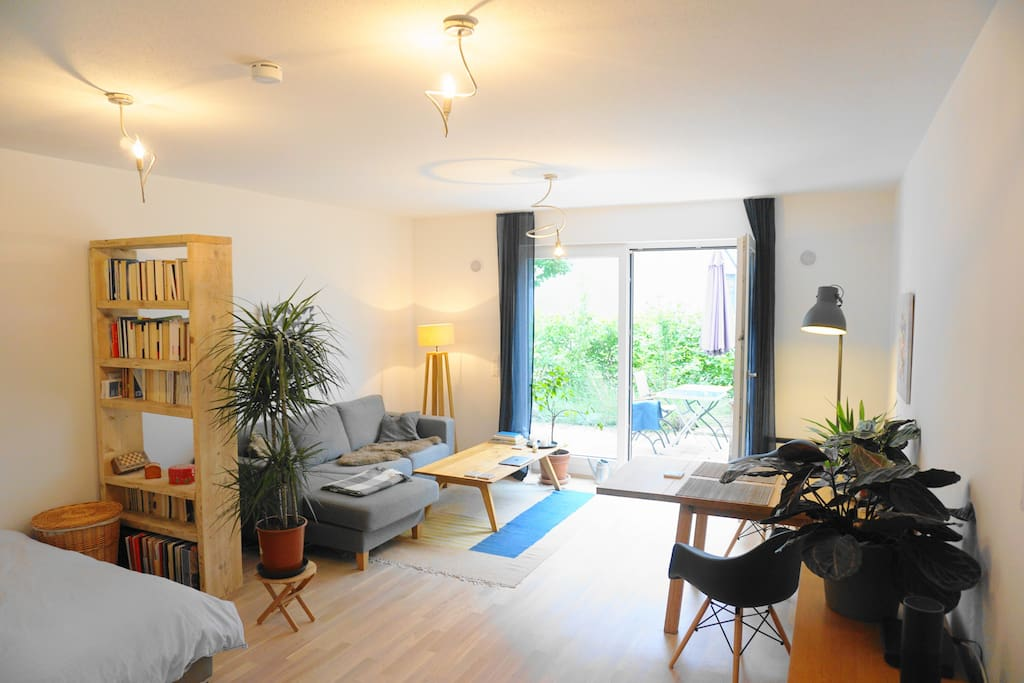 The spacious living area offers direct access to a terrace.