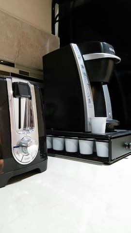 Keurig coffee-maker, toaster and microwave.