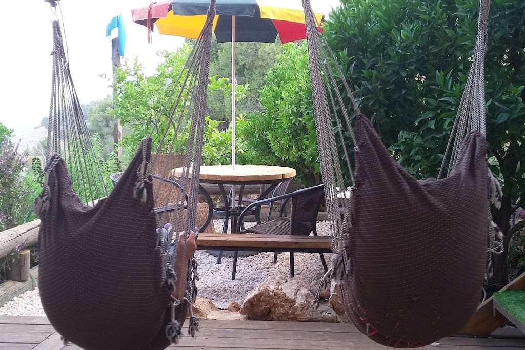Welcome to Shanti heaven. The backyard swings invite you to sit and relax. hammock swings on the wrap around porch kissing the mountain-side.