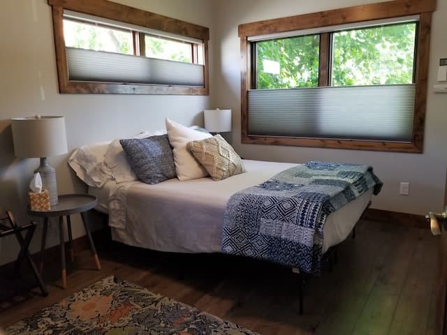 Bedroom with Queen bed, large closet, and ceiling fan.