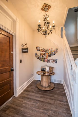 """Informational brochures and menus from Omaha's favorite attractions and restaurants can be found in the Foyer!  Your unit """"Barnwood"""" is through the door on the left. A separate unit is upstairs, """"Shiplap""""!"""