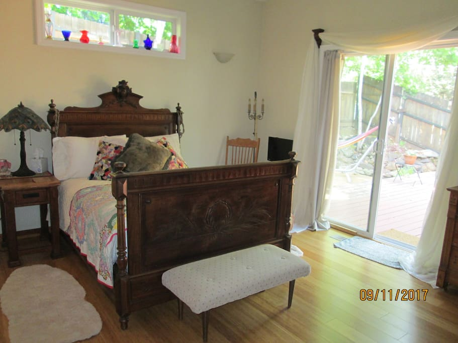 Master bedroom with slider leading to  backyard, pond and beautiful large deck for dining and relaxing