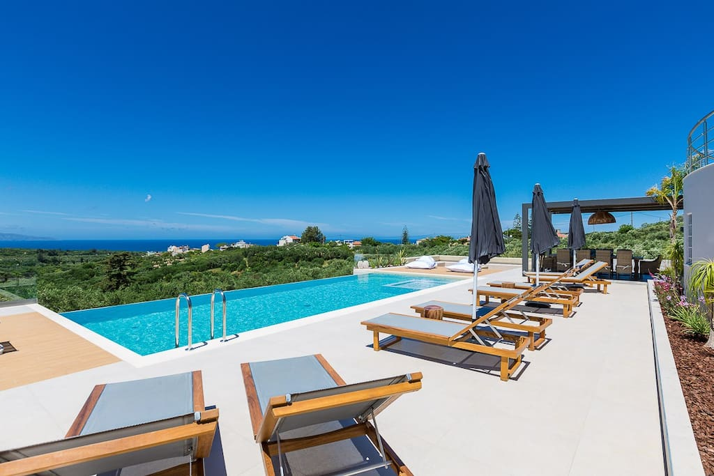 Pool area is equipped with enough sun loungers and parasols