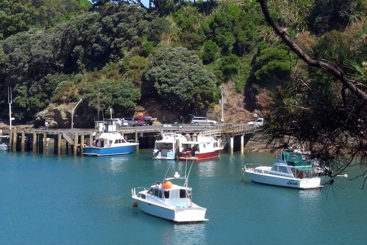 Leigh Harbour and wharf. There is a lovely walking track around the harbour through native bush and 2 beaches.