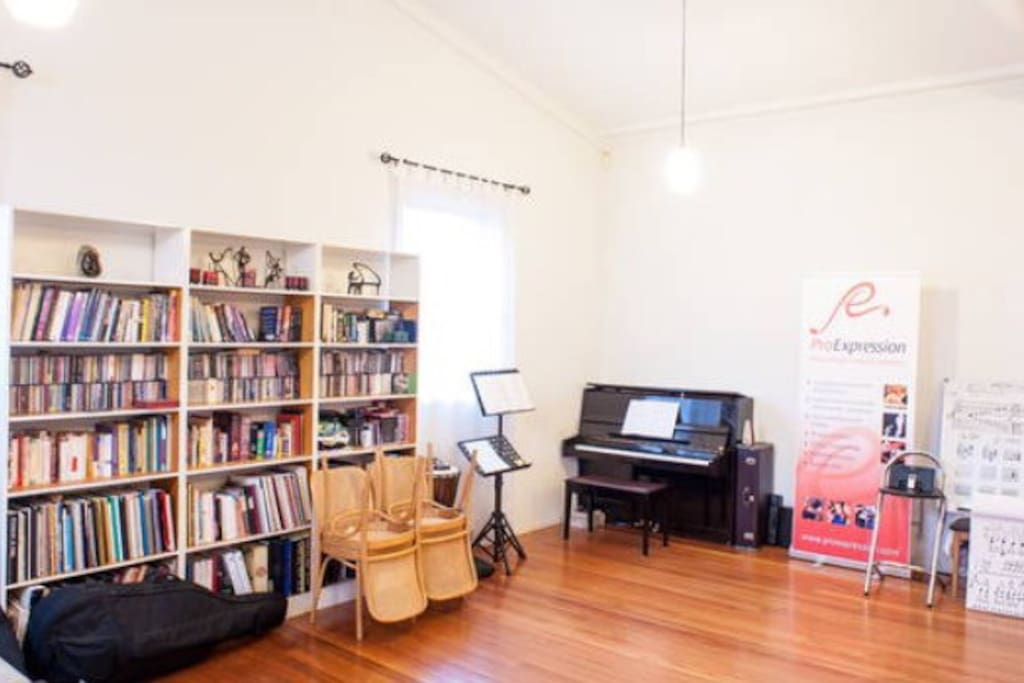 The main room - a welcome, bright, spacious music teaching and lounge room.  The couch is so comfy to relax on, read a book or act as two extra sleeping spaces..