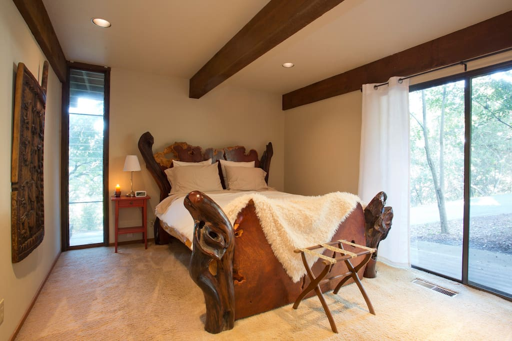 You'll see a lot of redwood throughout the house, but this bed is made of redwood burl.  It adds to the flair of the unique property!