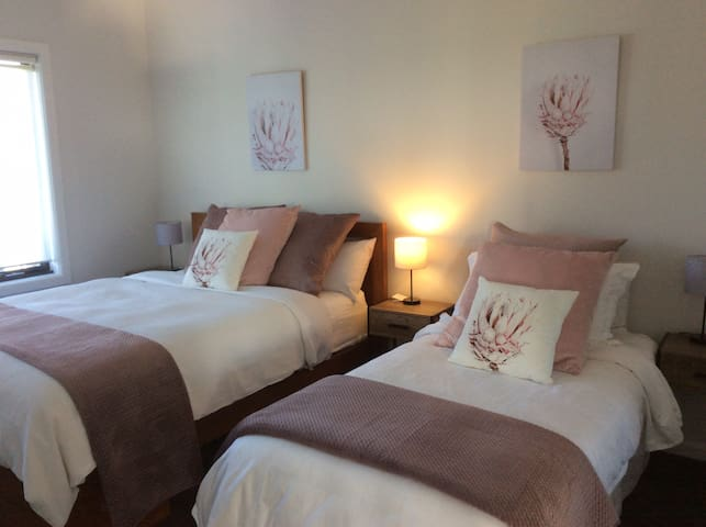 Family room sleeps 4.Please note queen, single and trundle