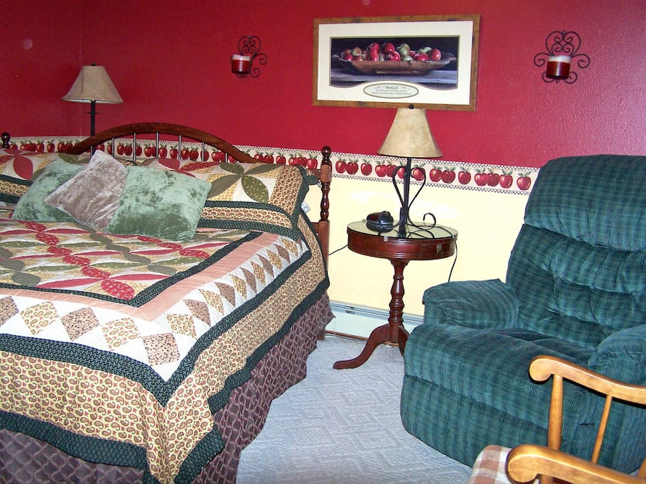Red Delicious Room with a King size bed and a private bathroom with a large jetted tub/shower.