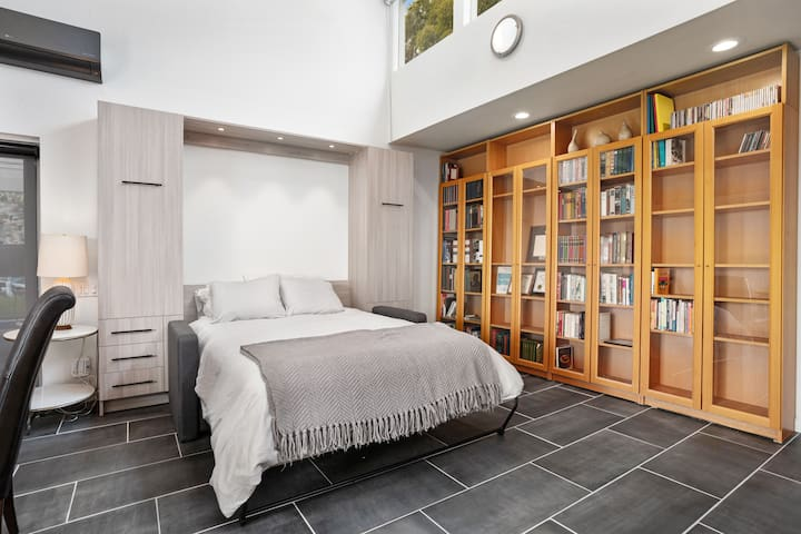 Pillowtop Queen Murphy Bed with storage & drawers, handy pull out nightstand each side.  Overhead recessed lighting controlled by remote. Handy charging outlets on each side.