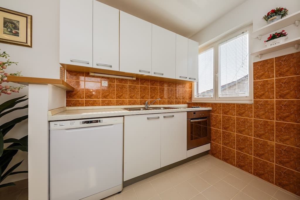 Dishwasher, sink and oven