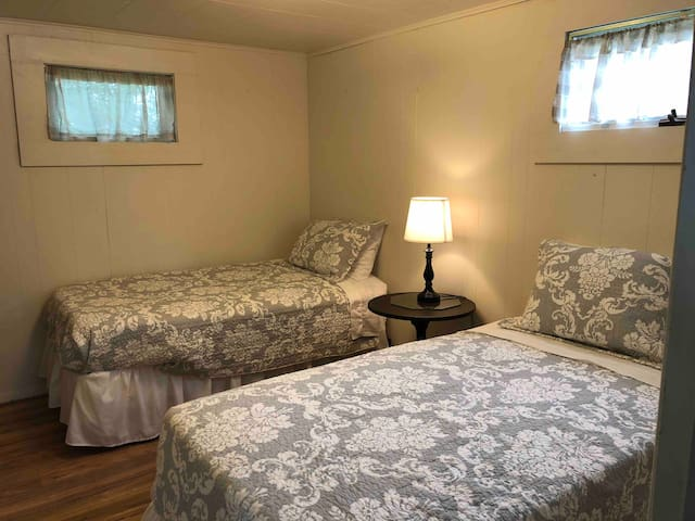 Twin beds in second bedroom.  Comforter colors vary.