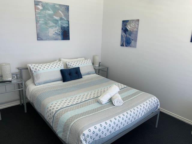 Bedroom one  Queen bed and TV