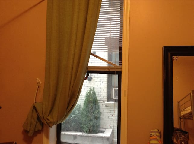 This is the window in the bedroom facing the entrance to the building...