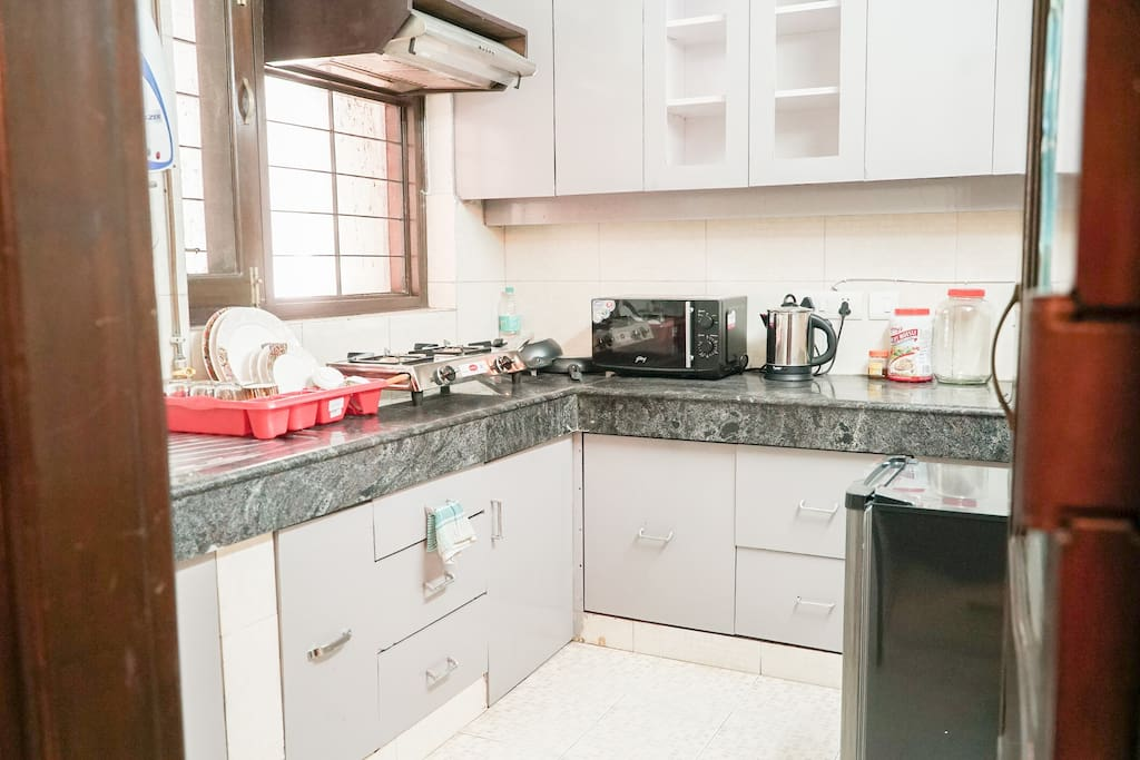 Fully equipped Kitchen with Coffee maker, Tea Kettle, Oven, and Supplies.