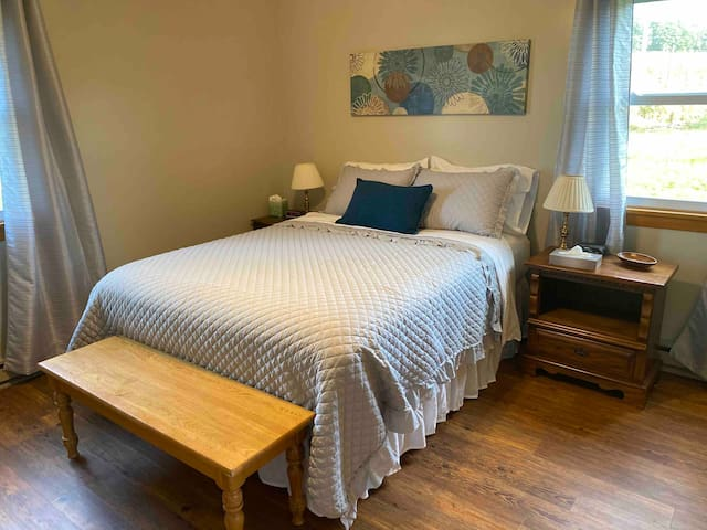 Spend the night on this comfy queen bed. There is a ceiling fan and sound machine for those who need the hum! We also have room darkening curtains!