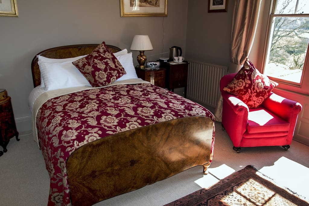 The antique double sized bed in the Walnut Room.