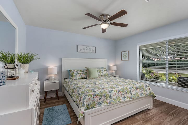Front guest room with queen bed, closet and dresser.