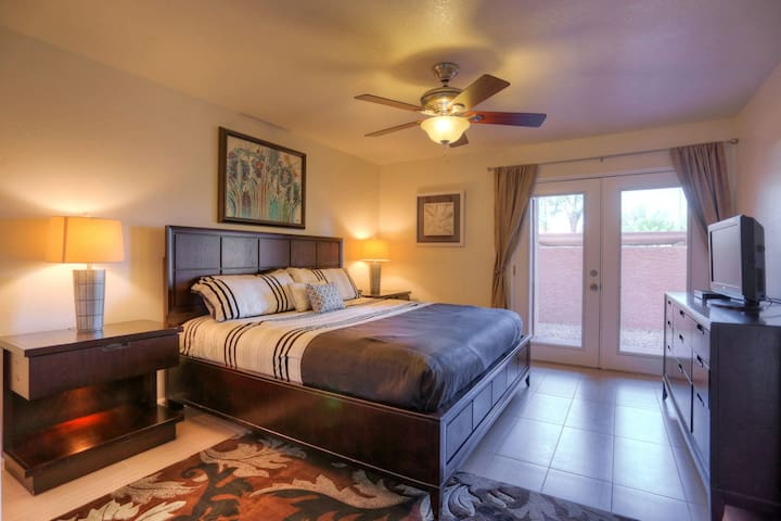 Master bedroom has deluxe king bed and french doors to patio