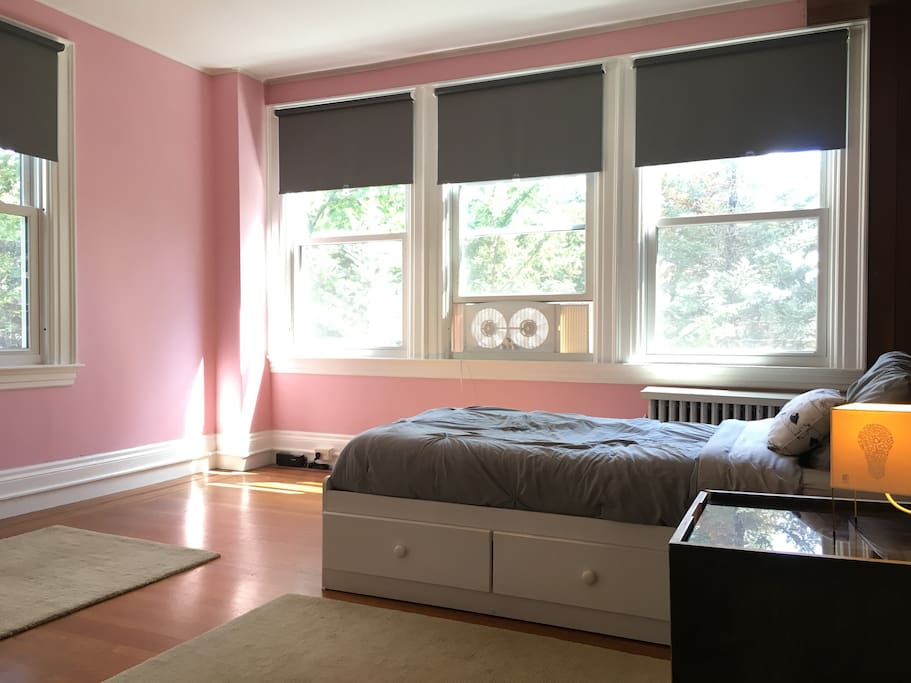 The room has wonderful natural light due to the many windows.