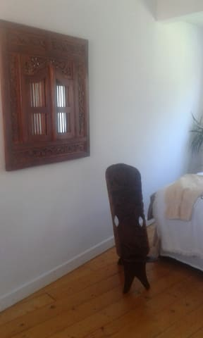 Mirror and area of guest bedroom