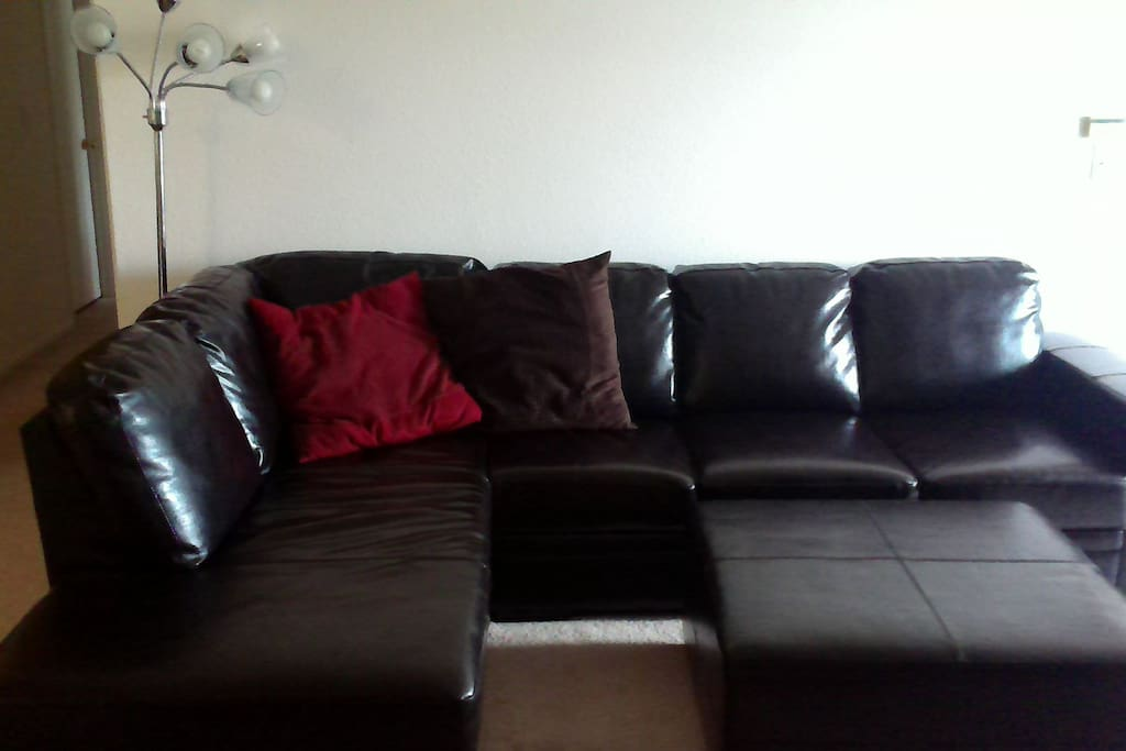 Nice couch in living room to watch tv and movies.