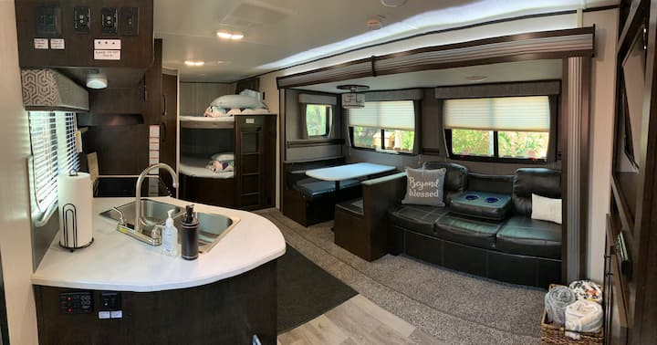 Modern Rv with private secure yard near DIA & DEN