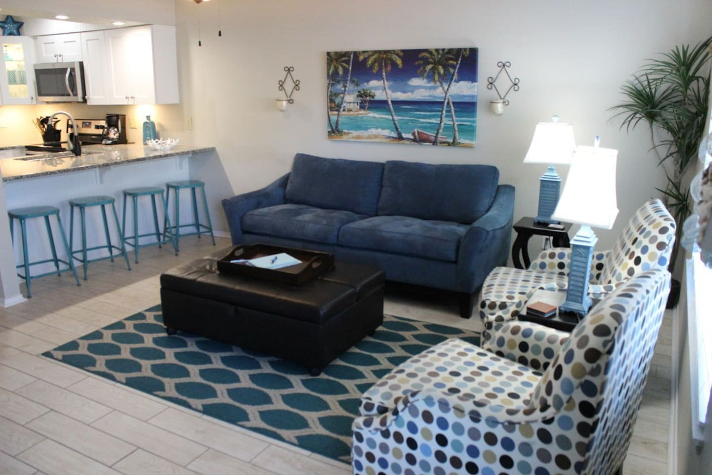 Sit back and relax in this charming and comfy living area with new sleeper sofa. The ottoman also folds into a twin sleeper for a small child.