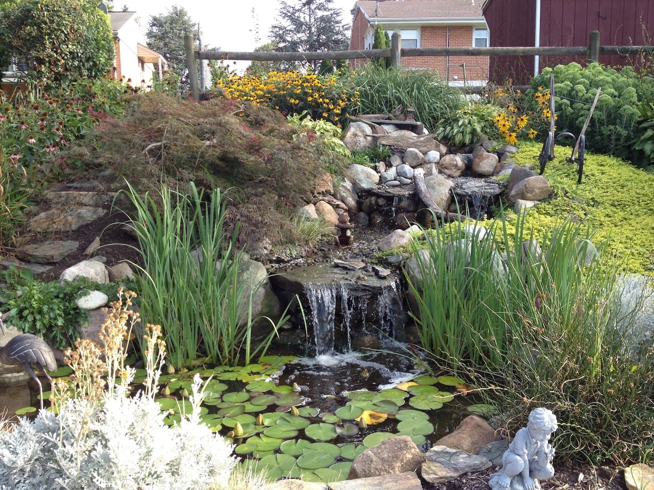 Beautiful landscaped garden with waterfall and fish pond