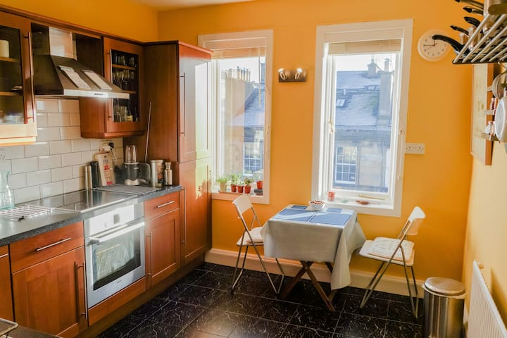 Bright and fresh kitchen with seating for enjoying your delicious meals.