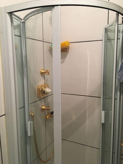 Sleek, updated bathroom with shower.