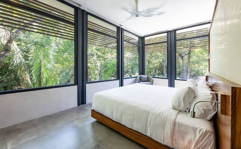 bedroom 1 = corner master suite with all around windows. pool and jungle view