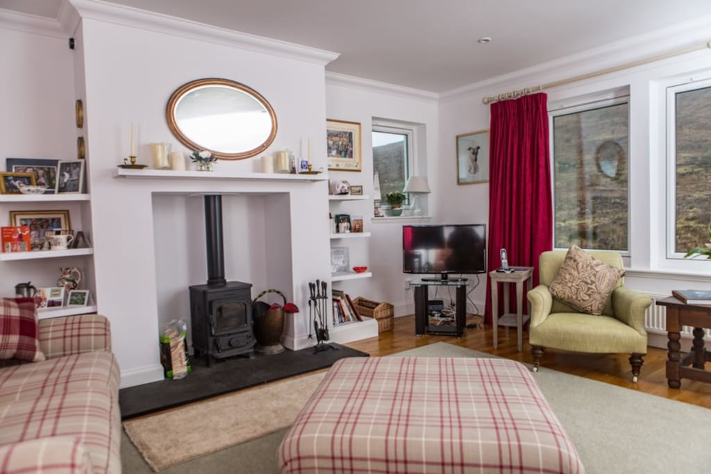 Sitting room with woodburner fire
