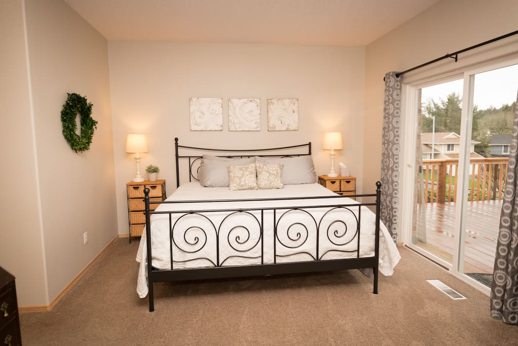 Spacious Master Bedroom with door to outdoor private yard and deck