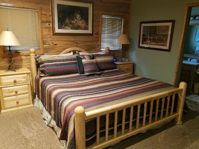 OUR MASTER BEDROOM WITH SPACIOUS BATHROOM.  WE HAVE A NICE KING SIZE BED