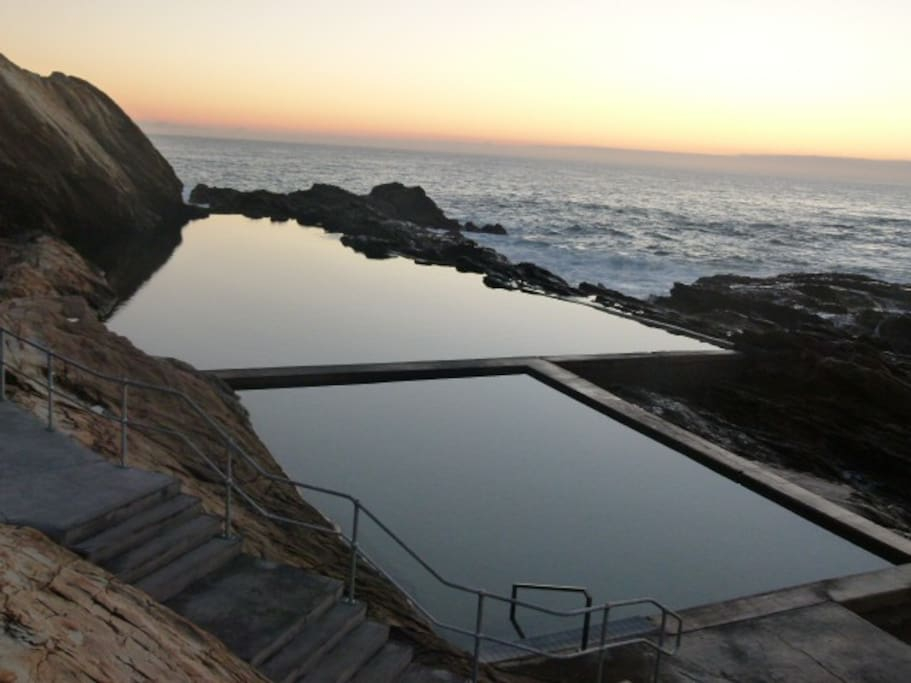 Our beautiful Blue pools with in a sort walk from the cottages .
