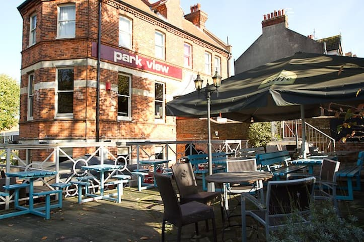 The Park View pub. Especially lovely outside on warm days. A stone's throw from the park itself!