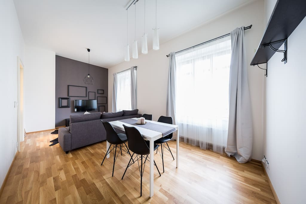Living/dining room is connected to the kitchen. The couch can be converted into a comfy 160cm lodging.