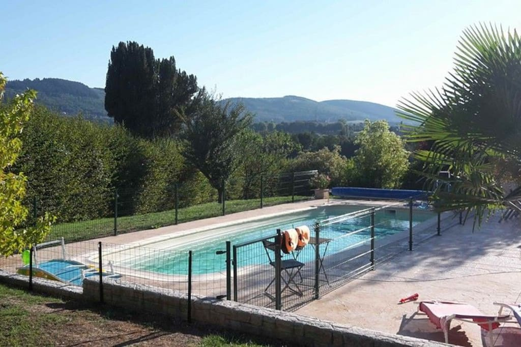 You have a beautiful view on the surrounding hills while swimming!