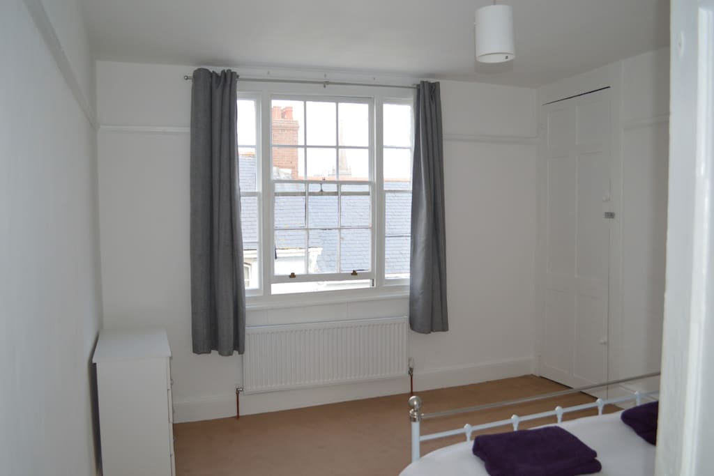 Large, bright and airy double bedroom  with comfortable mattress.