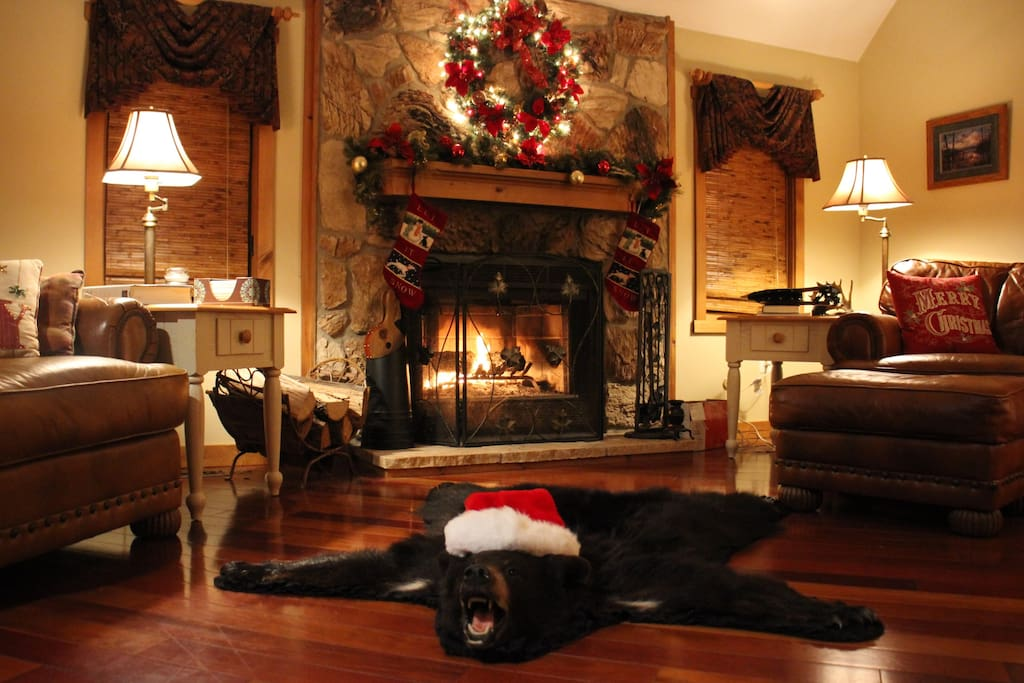 The hearth is flanked with stockings and decorated with a wreath and garland from the weekend before Thanksgiving through the Epiphany.  Even the bear gets into the holiday spirit!