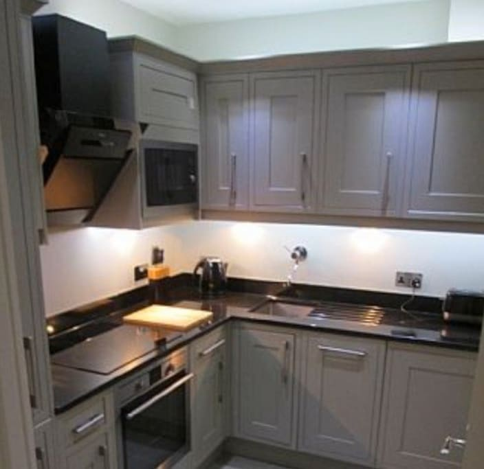 fitted kitchen with granite work top