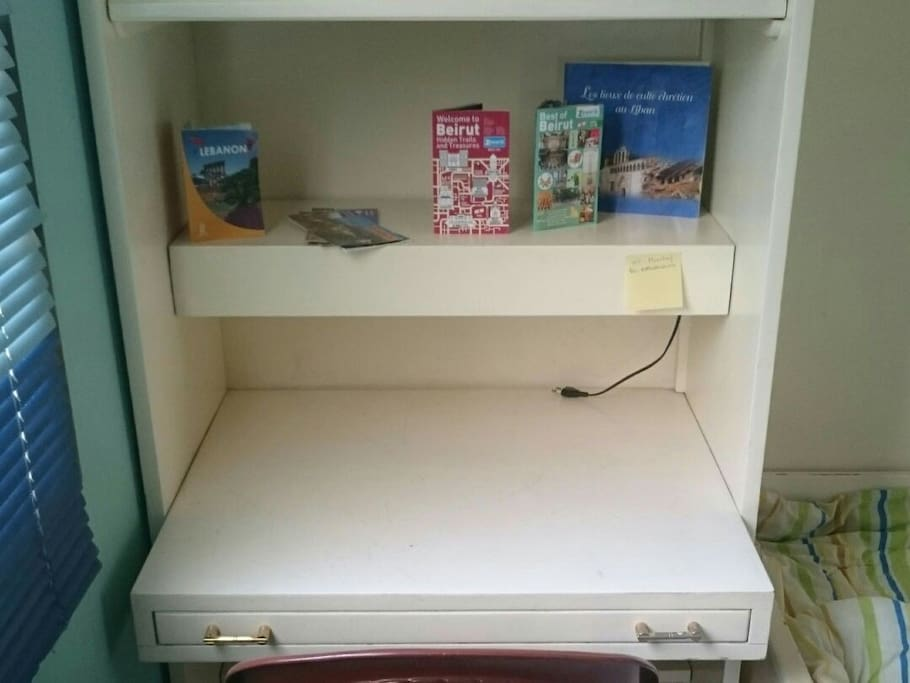 Private desk with some maps and touring guides
