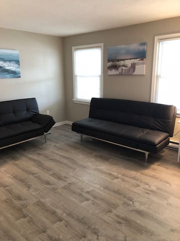 living room with 2 couches that convert to 2 full size beds