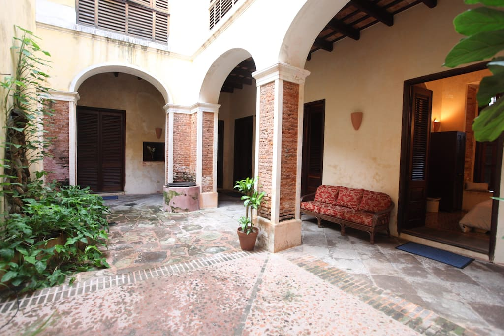 Three bedrooms with plush linens open into the restful courtyard. Each room has custom moroccan tile floors, and beautiful historical touches such as marble in-room sinks, carved wood arches, exposed brick and handmade sconces.