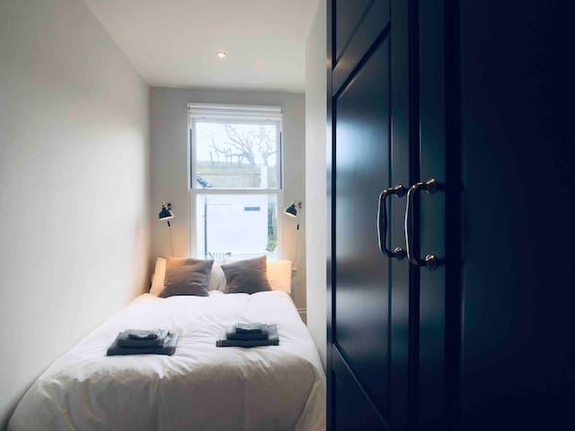 Cosy compact double room, with large double bed and large double wardrobe.