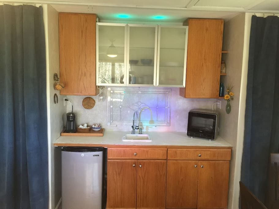 Cook in your Kitchen complete with sink,refrigerator, microwave, toaster, oven, dishware, wraps, pot